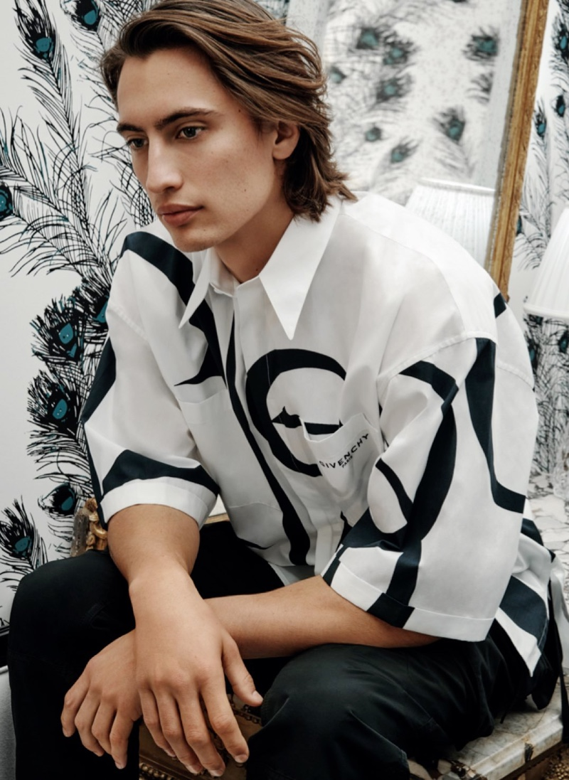 Making a graphic statement, James models an oversized shirt from Givenchy for Holt Renfrew.