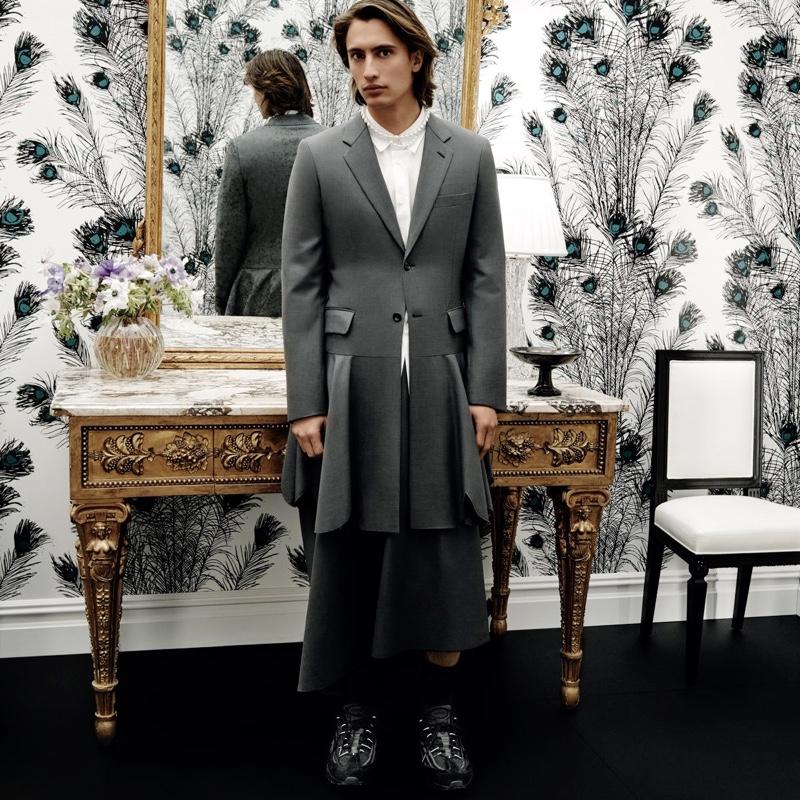 Front and center, James Turlington models a Comme des Garçons Homme Plus wool peplum jacket.