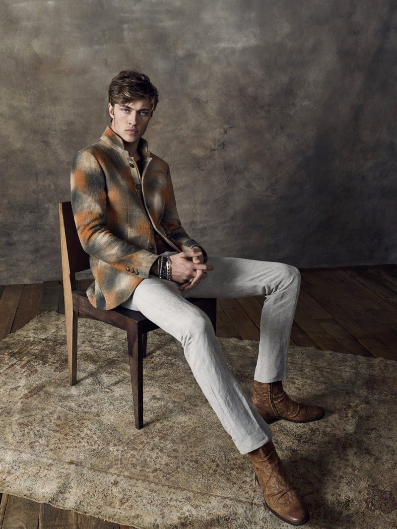Lucky Blue Smith dons a checked jacket for John Varvatos' spring-summer 2020 campaign.