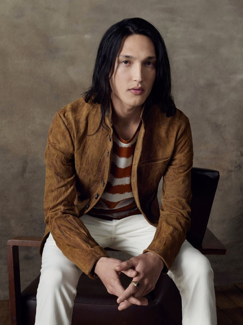 Joshua Smoot sports a suede jacket with light colored jeans for John Varvatos' spring-summer 2020 campaign.