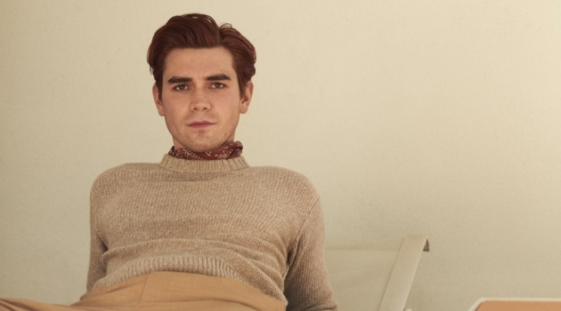 Connecting with Mr Porter, KJ Apa sports a Loro Piana cashmere sweater, Barena trousers, and a Drake's printed pocket square.