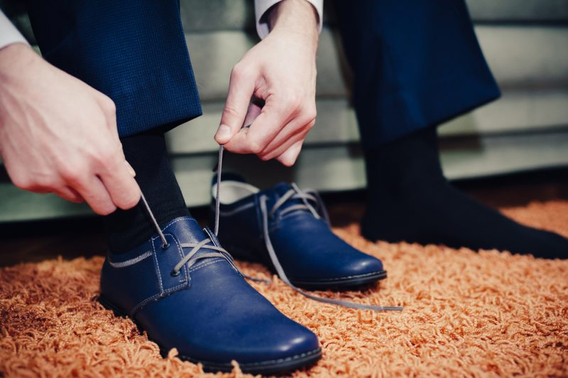 Man Putting on Dress Shoes