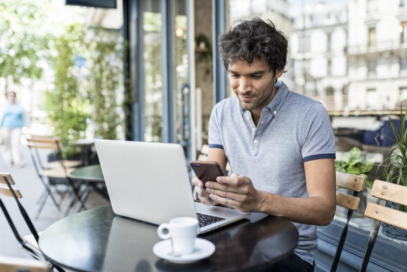 Man on Laptop and Phone