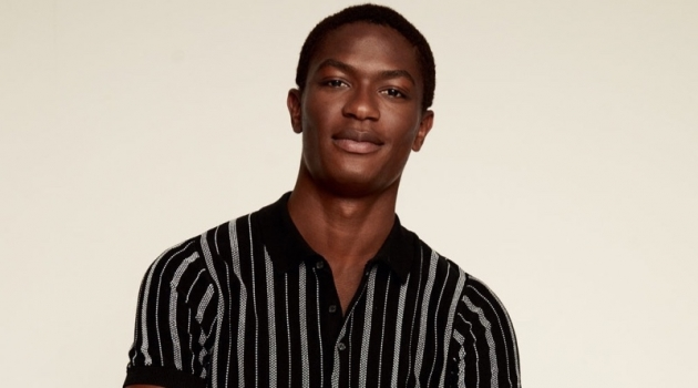Reuniting with Mango, Hamid Onifade models a striped knit polo.