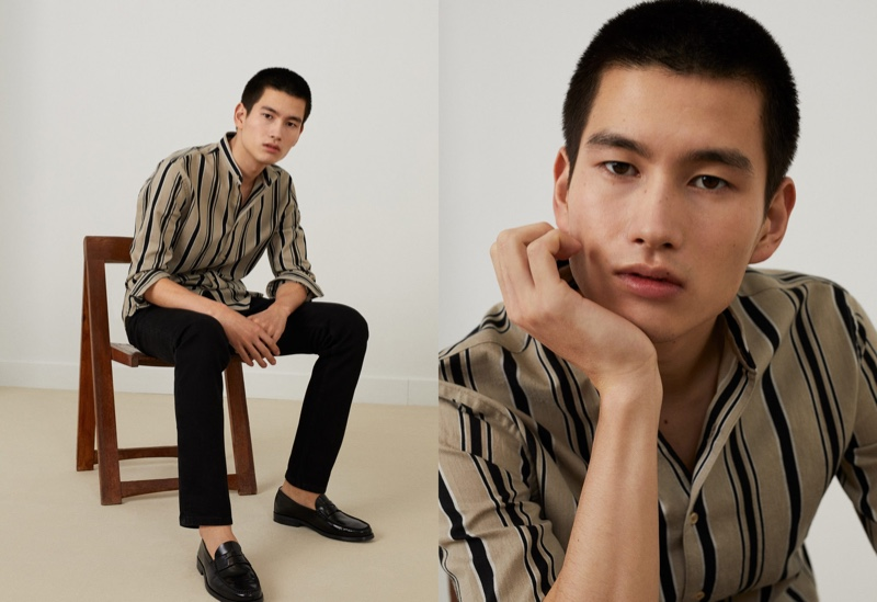 Taking to the studio, Kohei Takabatake dons a striped shirt with black pants from Mango.