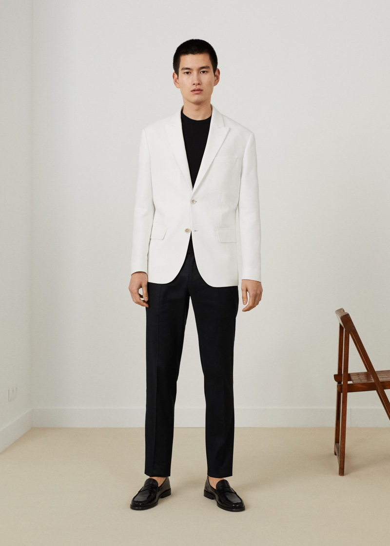 A sharp vision, Kohei Takabatake sports a white suit jacket with black pieces from Mango.