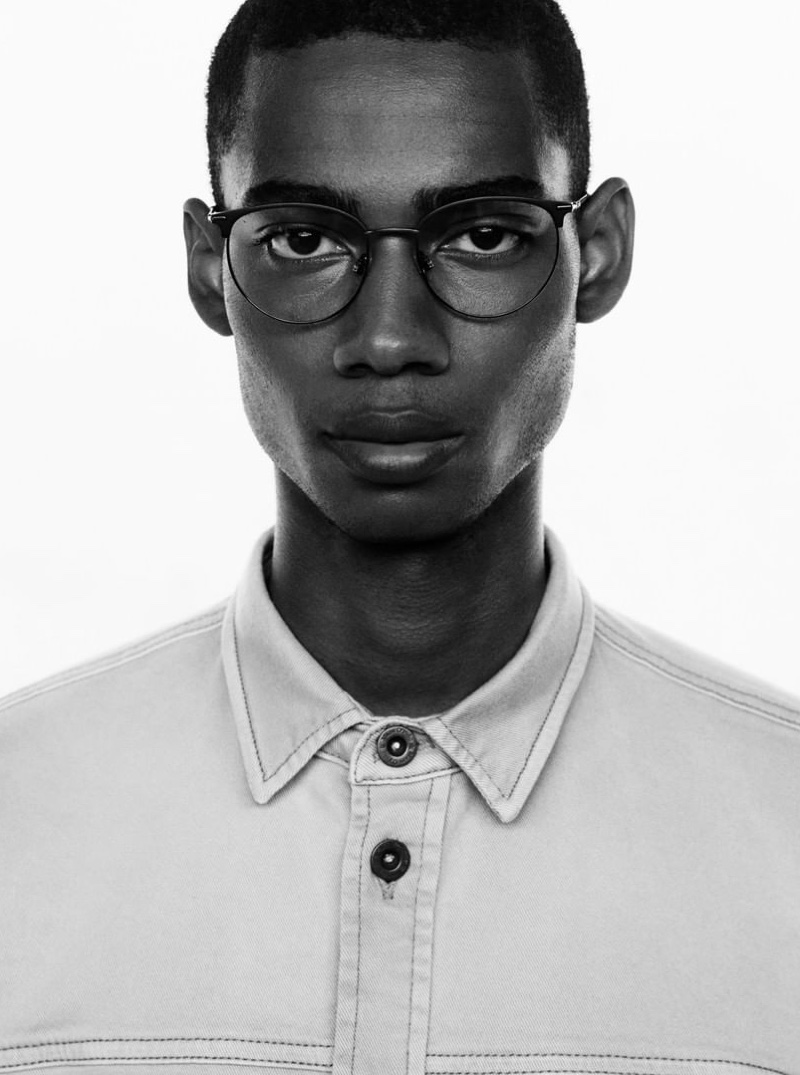 A smart vision in glasses, Keiron Caynes stars in Marc O'Polo's spring-summer 2020 campaign.