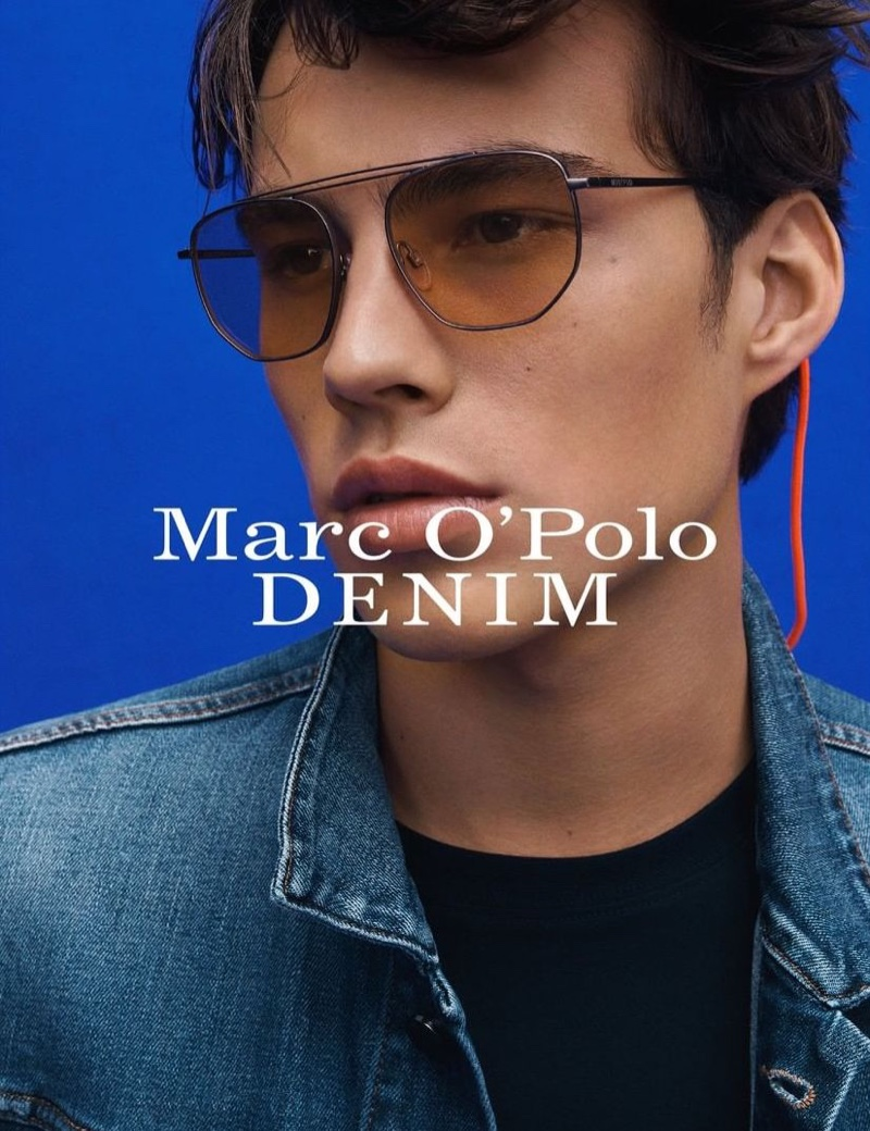 A cool vision in shades, Louis Baines fronts Marc O'Polo's spring-summer 2020 denim campaign.