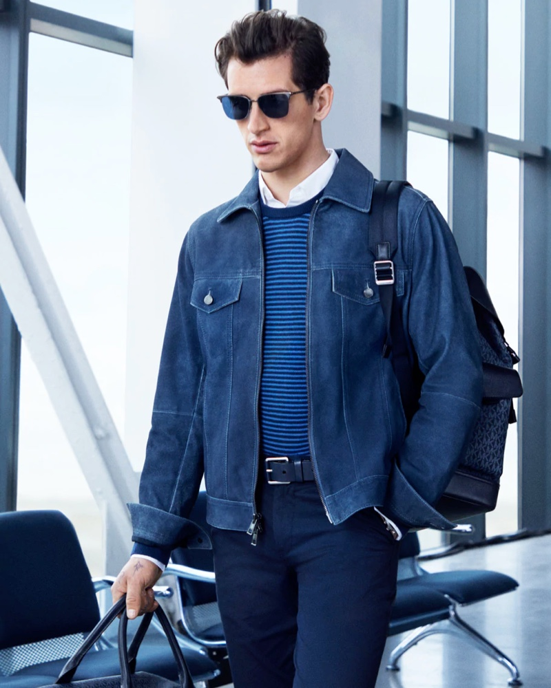 Donning a smart look in navy, Austin Augie stars in Michael Kors' spring-summer 2020 campaign.