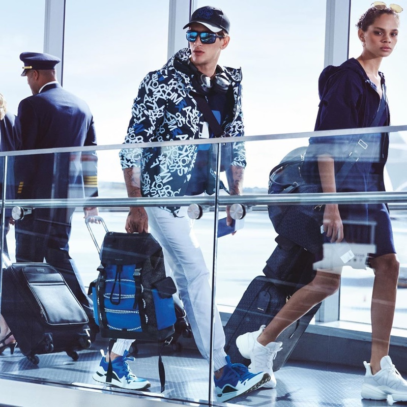 Navigating his way through the airport, Austin Augie appears in Michael Kors' spring-summer 2020 campaign.