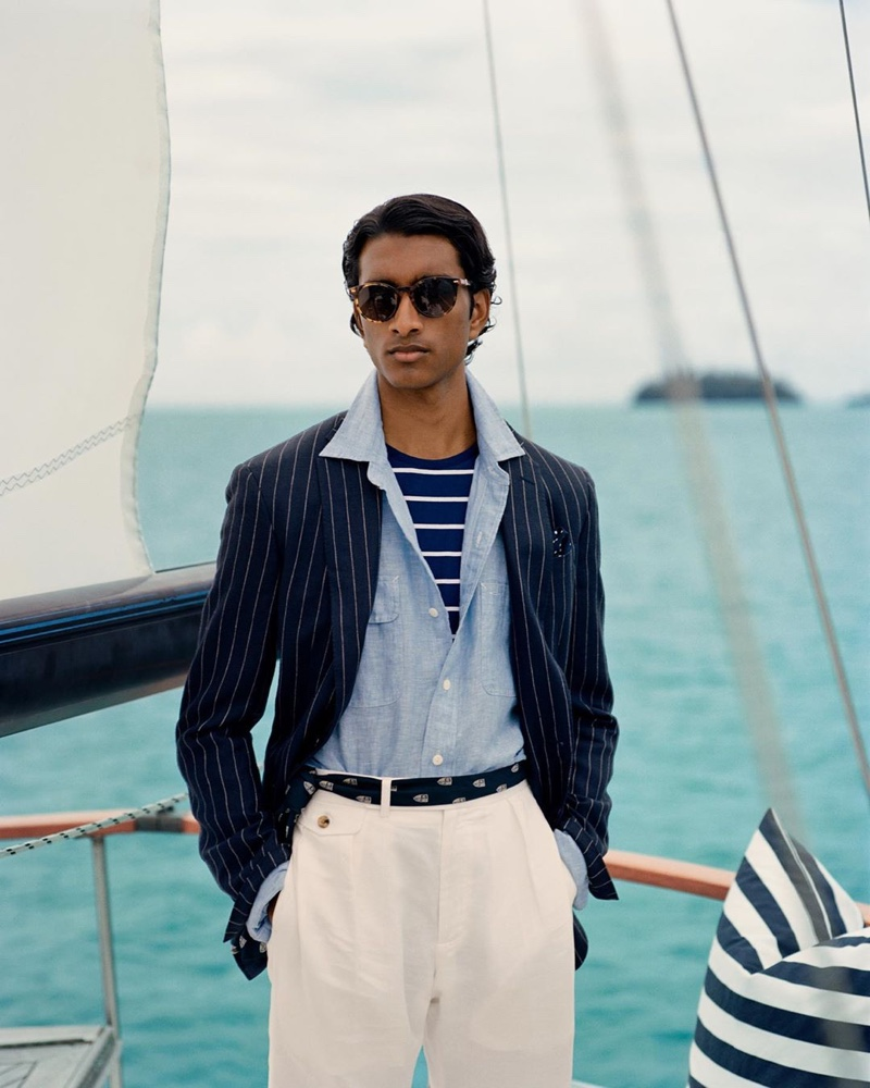 Jeenu Mahadevan embraces smart style in a pinstripe jacket, linen shirt, striped tee, and beige trousers from POLO Ralph Lauren.