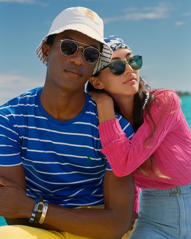 A summer vision, Hamid Onifade rocks shades with a striped tee and yellow pants from POLO Ralph Lauren.