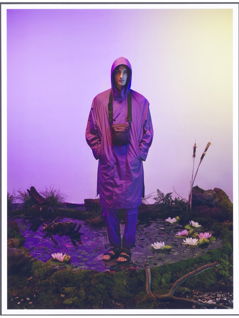 Front and center, Aaron Shandel models a purple waterproof coat from Reserved's Re Design collection.