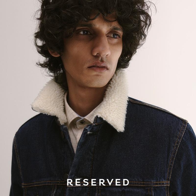 Sporting a denim trucker jacket, Mustafa Dawood models for Reserved.