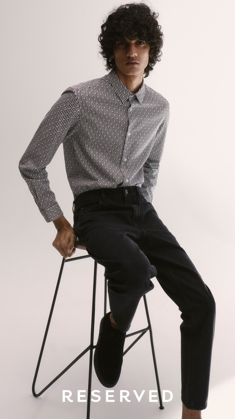Model Mustafa Dawood dons a printed shirt with black jeans from Reserved.