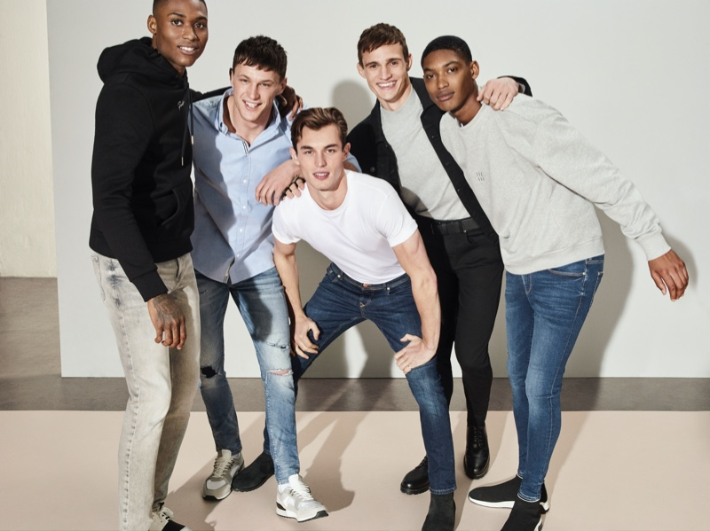 All smiles, Karl Rawlings, Jack Buchanan, Kit Butler, Julian Schneyder, and Timothy Lewis front River Island's spring-summer 2020 denim campaign.