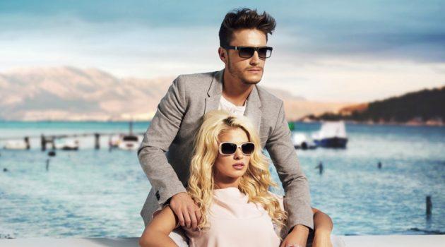 Stylish Couple Man Suit Woman Pink Top Sunglasses