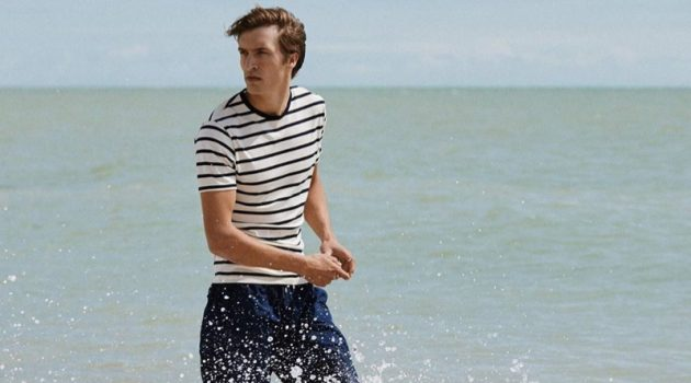 Taking to the beach, Tim Dibble appears in Sunspel's spring-summer 2020 campaign.