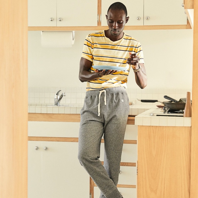 Front and center, Armando Cabral wears a Todd Snyder Portuguese striped tee with Todd Snyder + Champion jogger sweatpants.