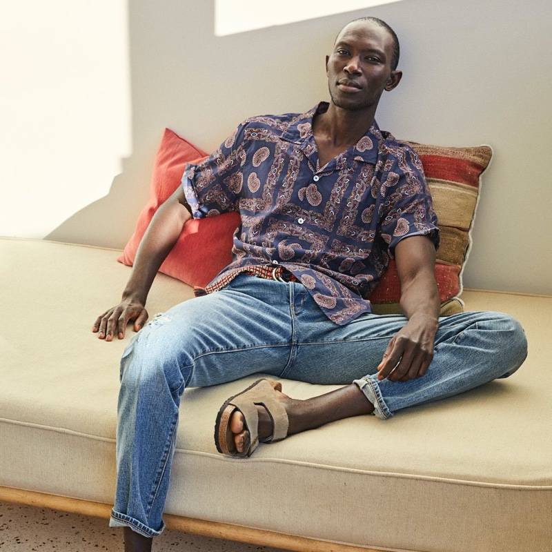 Relaxing, Armando Cabral sports a Todd Snyder bandana print camp collar shirt.