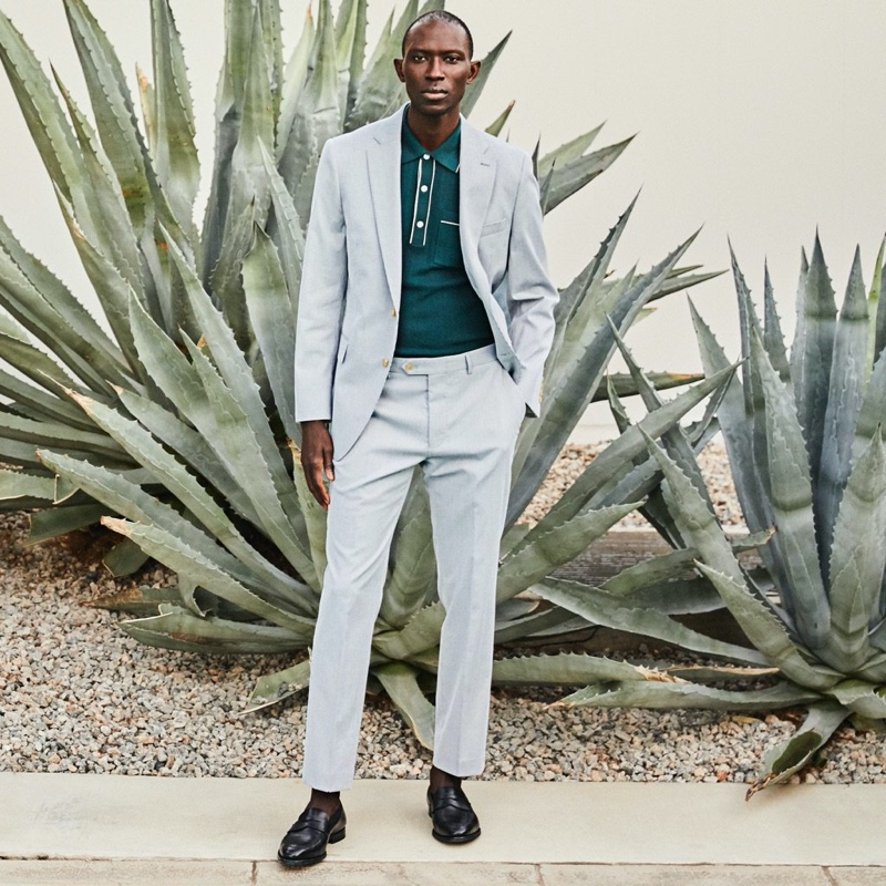 A smart vision, Armando Cabral wears a Todd Snyder Italian cotton silk tipped ribbed polo sweater in green with a Todd Snyder Black Label Sutton fine corded suit.