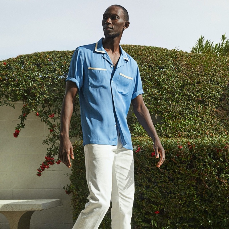 Model Armando Cabral rocks a Todd Snyder tipped bowling shirt in blue.