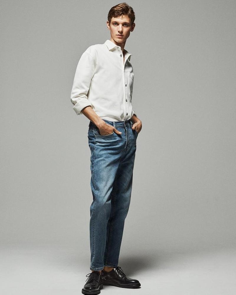 Jai Piccone steps into Zara's Standard Slim jeans.