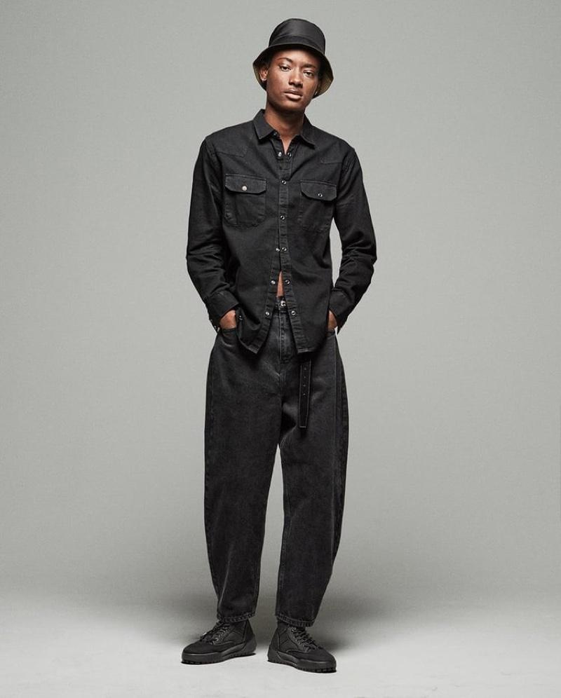 Youssouf Bamba wears Zara's Balloon denim jeans.
