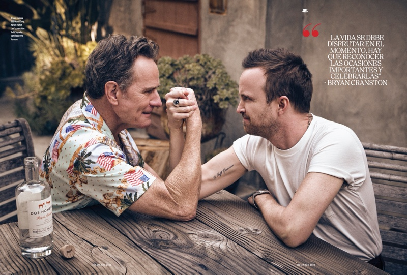 Arm wrestling, Bryan Cranston and Aaron Paul appear in a photo shoot for Esquire México. Cranston wears a SSS World Corp shirt while Paul dons a Levi's t-shirt with Todd Snyder pants.