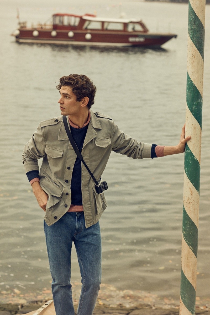On the move, Arthur Gosse wears a safari jacket with jeans from Brooksfield's spring-summer 2020 collection.