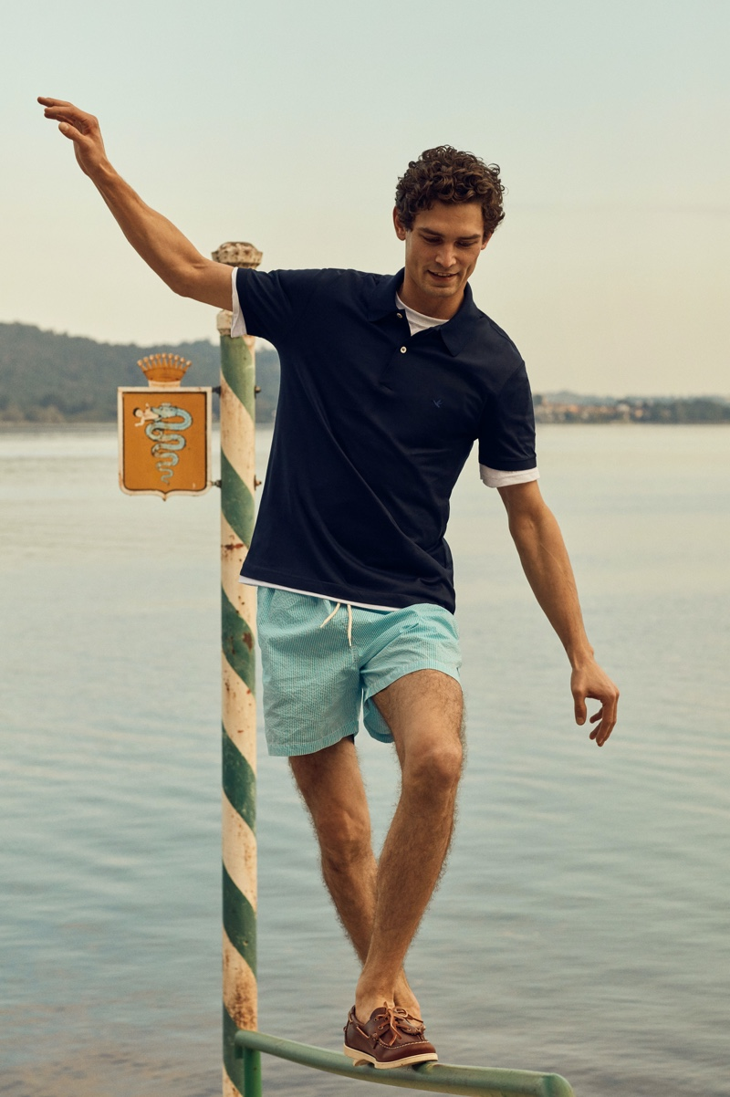 Dressed for warm weather, Arthur Gosse models a polo shirt with swim shorts from Brooksfield.