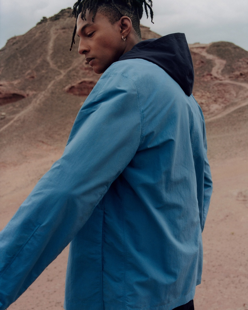 Sporting a cotton bomber jacket, Ty Ogunkoya connects with COS for spring-summer 2020.
