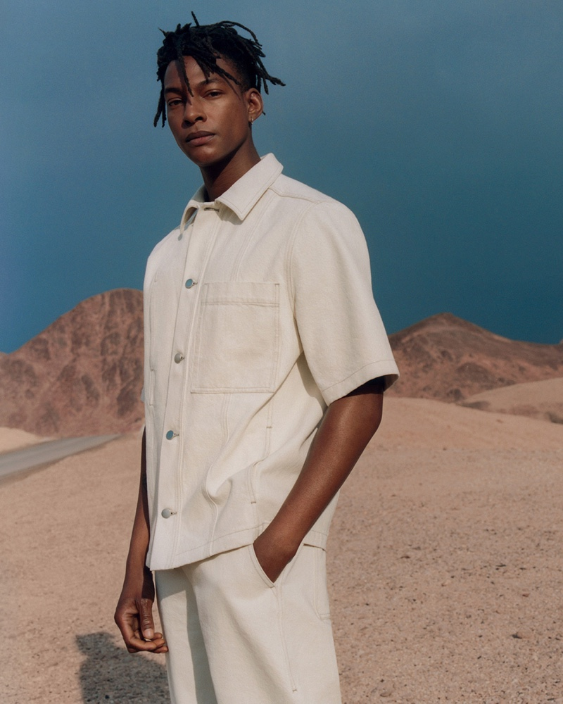 Ty Ogunkoya wears a short-sleeve denim shirt with matching pants from COS.