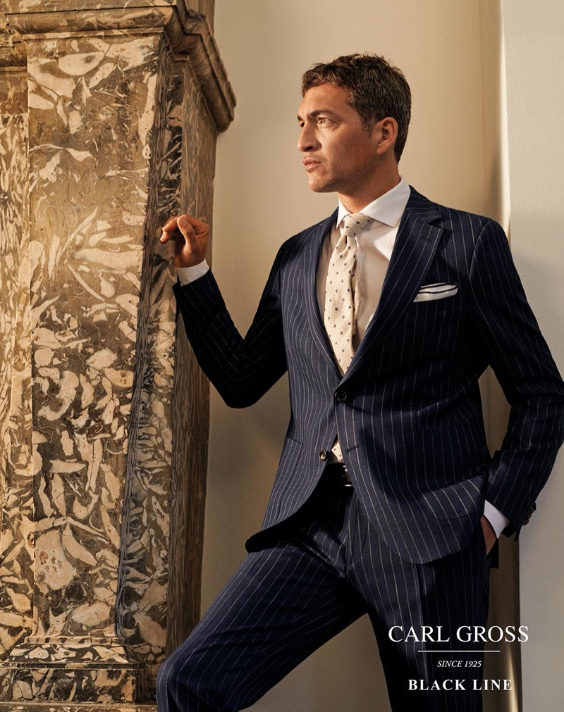 Donning a pinstripe suit, Ilay Kurelovic connects with Carl Gross Black Line for spring-summer 2020.