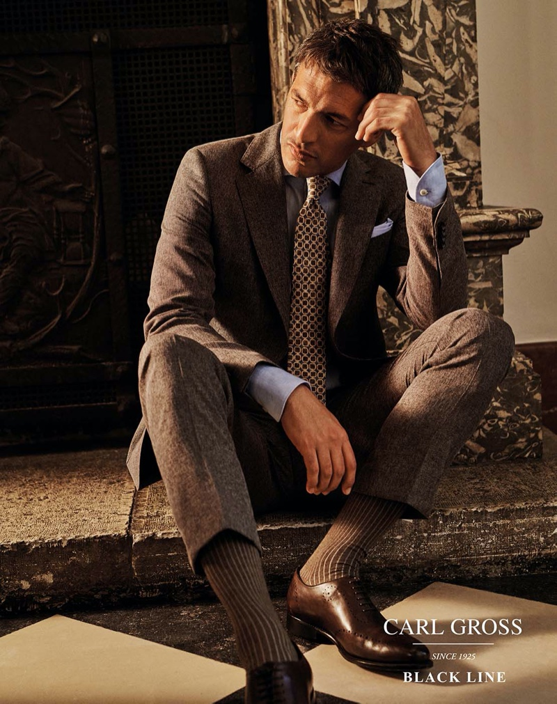 Making a case for brown, Ilay Kurelovic dons a sleek suit from Carl Gross Black Line's spring-summer 2020 collection.