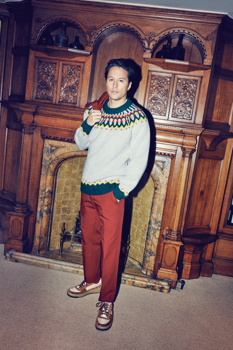 Front and center, Cary Joji Fukunaga wears a Dries Van Noten brick red suit, Burberry fair isle wool sweater, and Acne Studios sneakers.