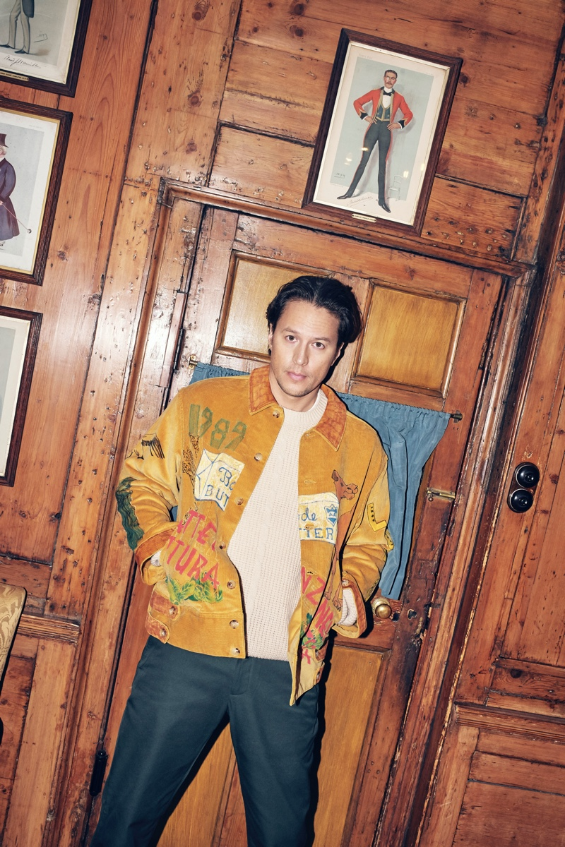 Connecting with Mr Porter, Cary Joji Fukunaga wears a Bode hand-illustrated corduroy jacket with a Gucci cable-knit sweater and tapered trousers.