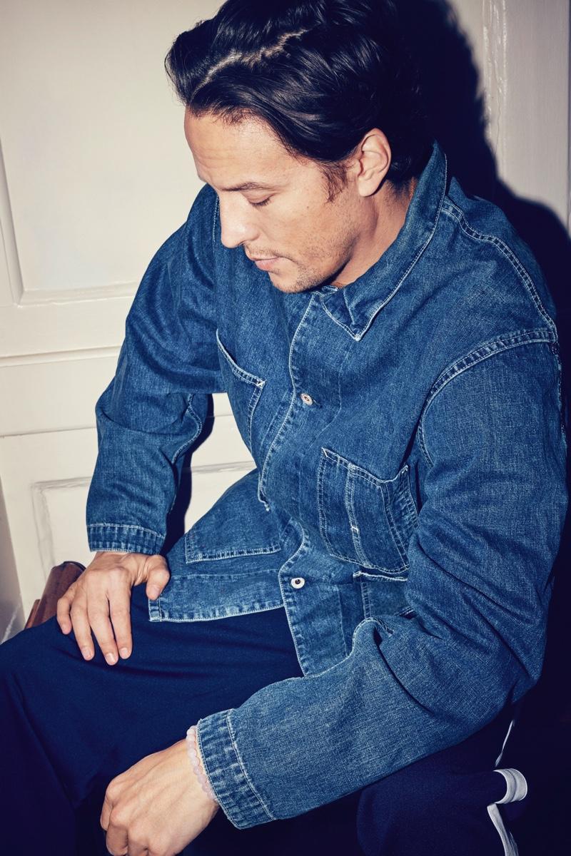 Making a case for workwear-inspired style, Cary Joji Fukunaga wears a Chimala distressed selvedge denim chore jacket.