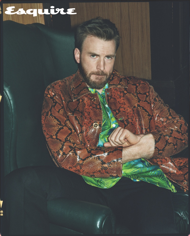 Starring in a new Esquire photo shoot, Chris Evans wears a shirt, snake print jacket, and pants by Versace. A RRL belt completes his designer look.
