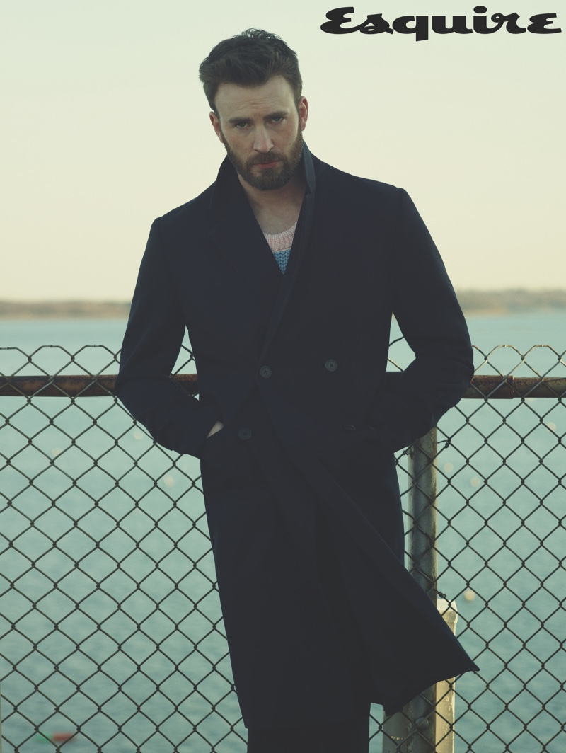 Linking up with Esquire for its April/May 2020 issue, Chris Evans sports a sweater, coat, and pants by Prada.