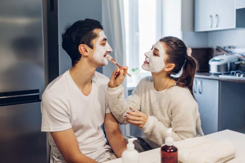 Couple Applying Face Masks