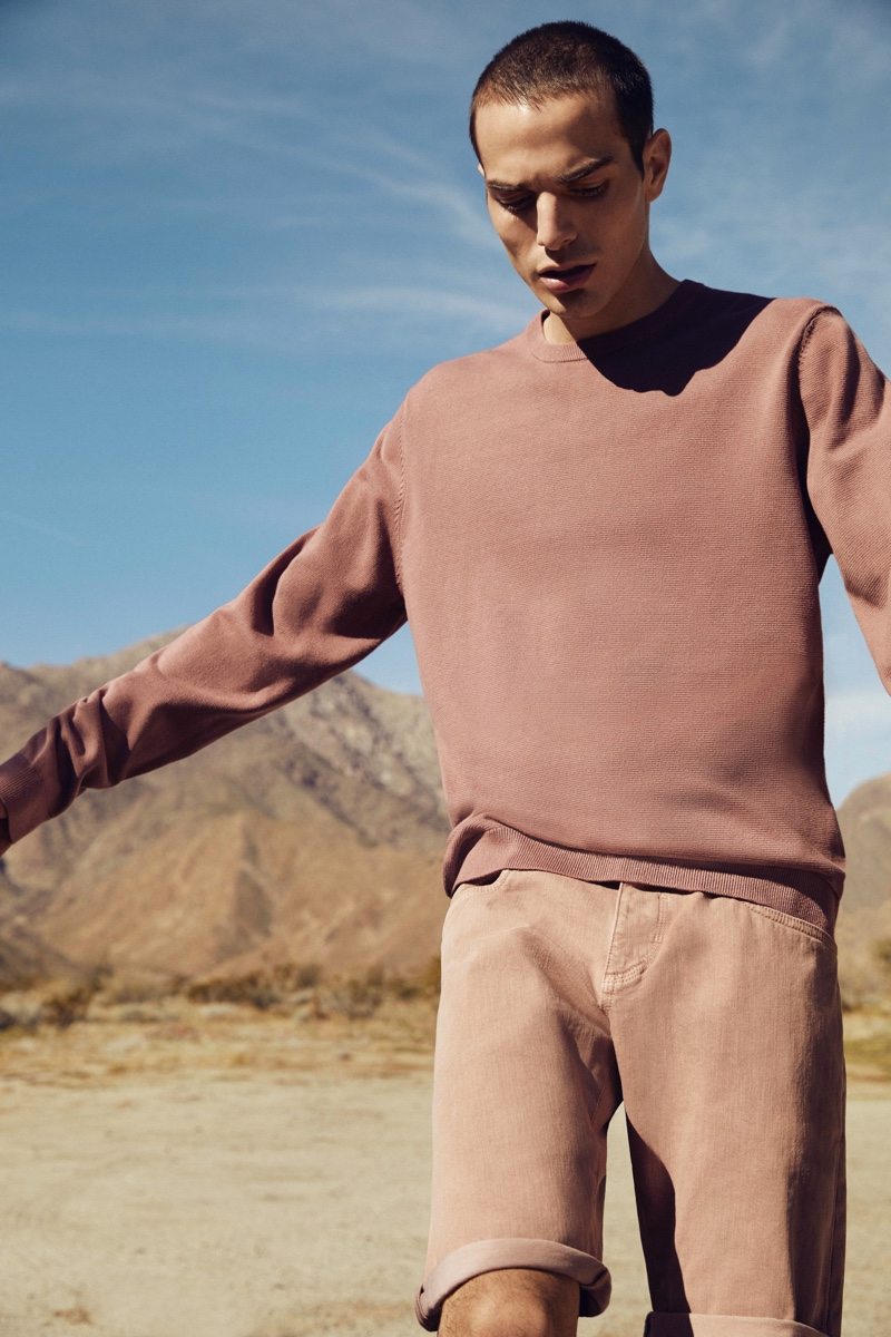 Embracing monochromatic style, David Friend dons a sweatshirt and shorts from Esprit's EarthColors capsule collection.