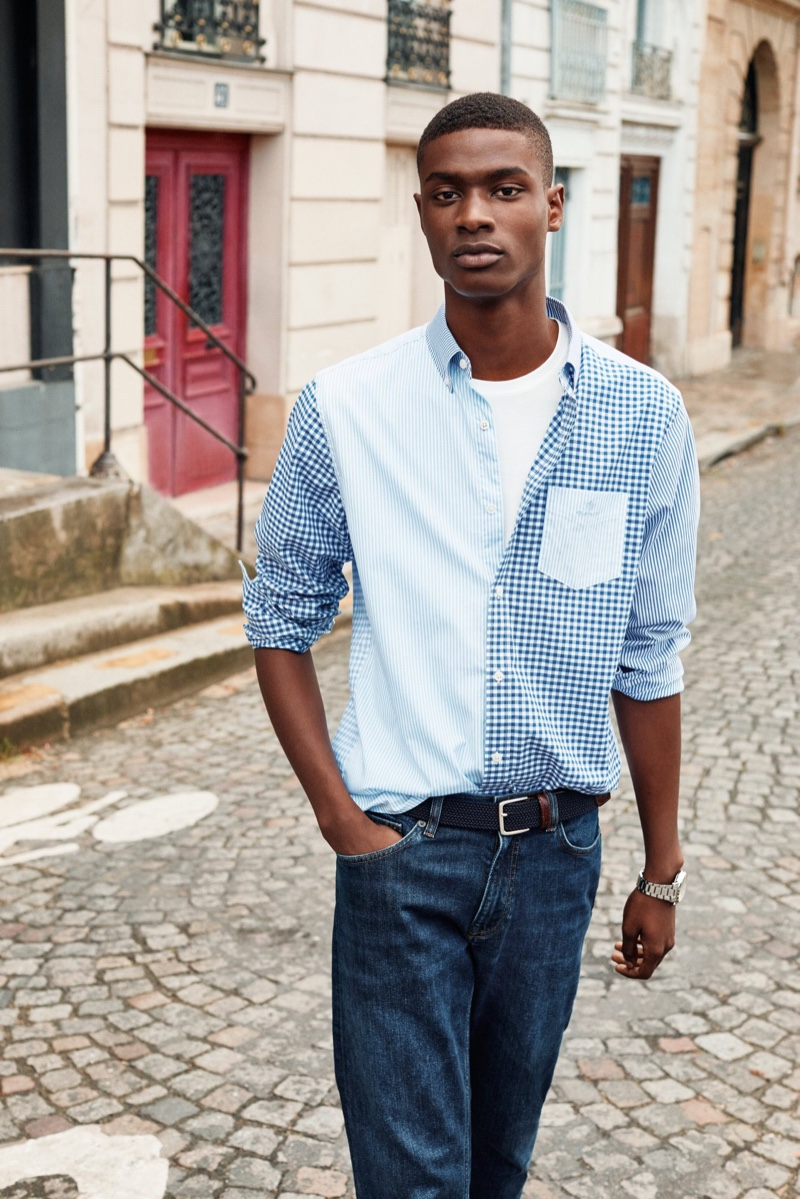 Taking to the streets of Paris, Rachide Embalo stands out in a colorblock shirt for GANT's spring 2020 campaign.