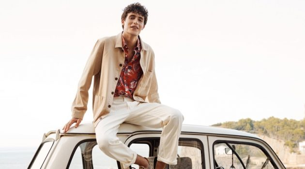Oscar Kindelan is a smart vision in a workwear-inspired jacket and tropical print shirt for GANT's spring-summer 2020 campaign.