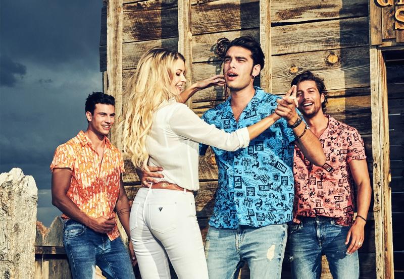 All smiles, Mattia Narducci, Erin Cummins, Stefano Sala, and Simone Susinna appear in GUESS' spring-summer 2020 campaign.