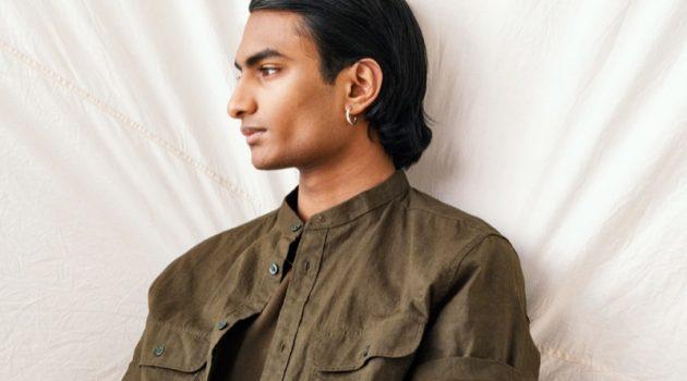 Robin Rishi dons a band-collar linen shirt from H&M.