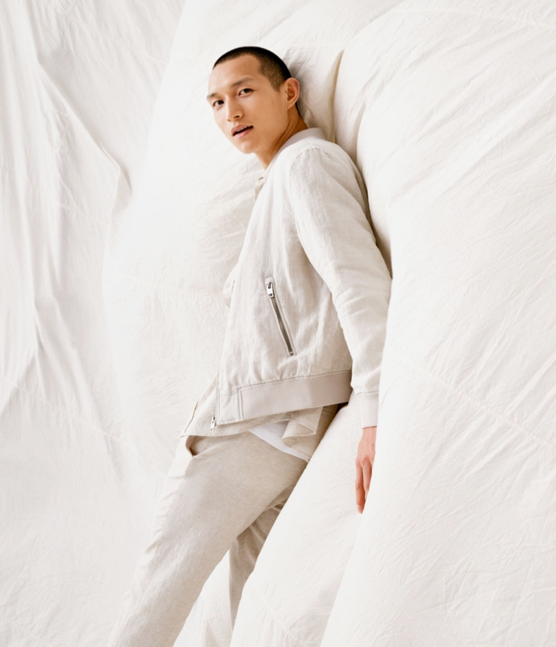Front and center, Zhang Wenhui sports a linen bomber jacket with skinny fit suit pants by H&M.