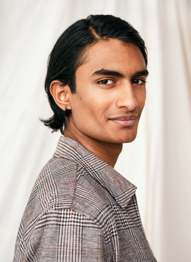 Charming with a smile, Robin Rishi models H&M's plaid linen-blend shirt jacket, or shacket.