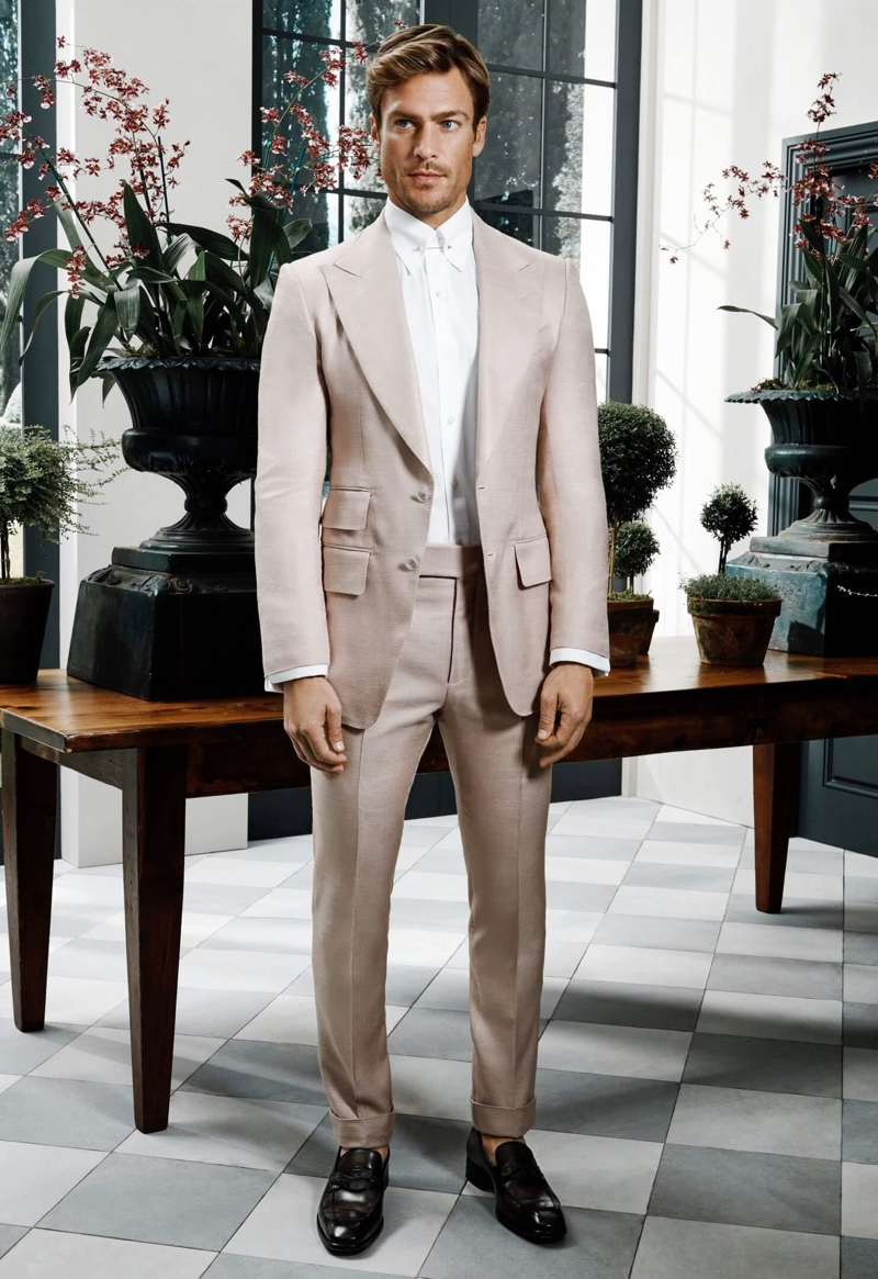 Jason Morgan is a dapper vision in a silk suit and leather loafers from Tom Ford for Holt Renfrew.