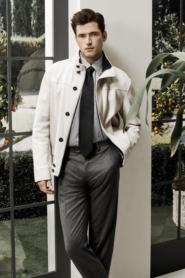 Sean O'Pry dons a Brioni leather bomber jacket with a striped shirt, wool trousers, and tie.